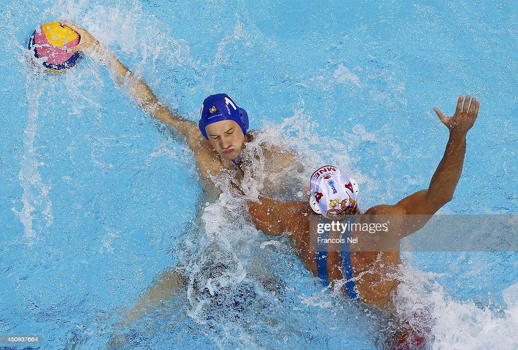Denes Varga of Hungary conrtols the ball against Antonio Petrovic of Montenegro during the Fina Men's Water Polo World League Super Semi Final match...