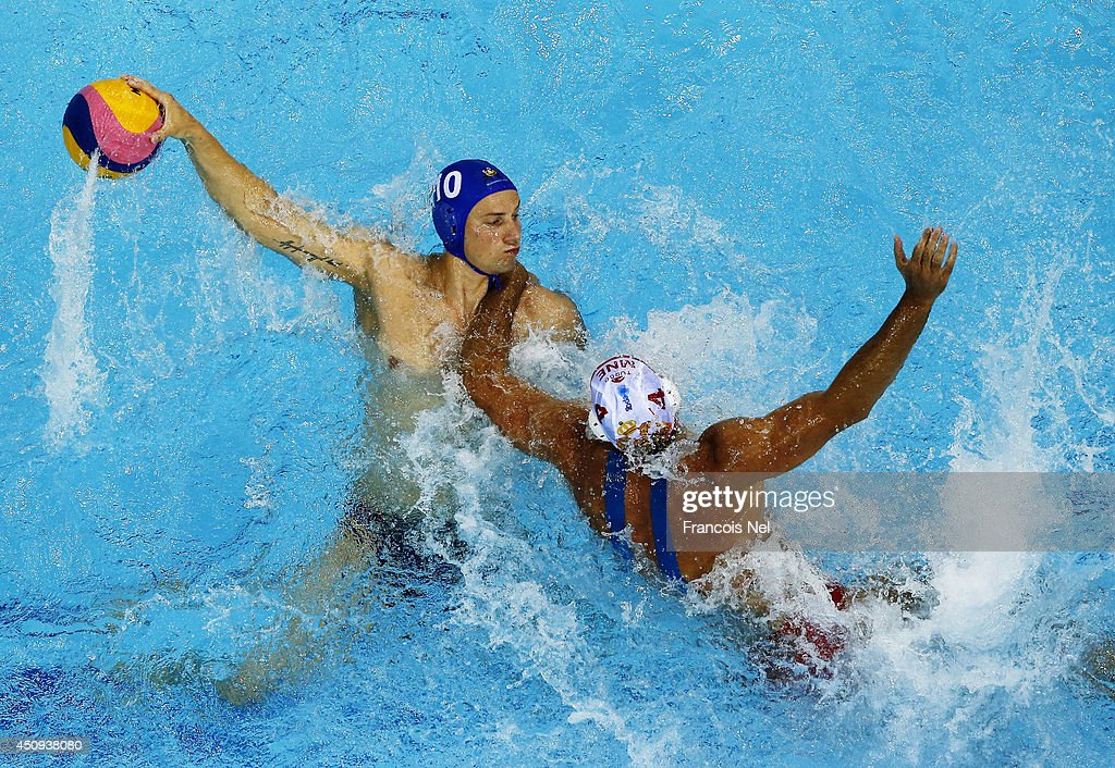 Denes Varga of Hungary controls the ball against Antonio Petrovic of Montenegro during the Fina Men's Water Polo World League Super Semi Final match between Hungary and Montenegro at the Hamdan Sports Complex on June 20, 2014 in Dubai, United Arab Emirates.