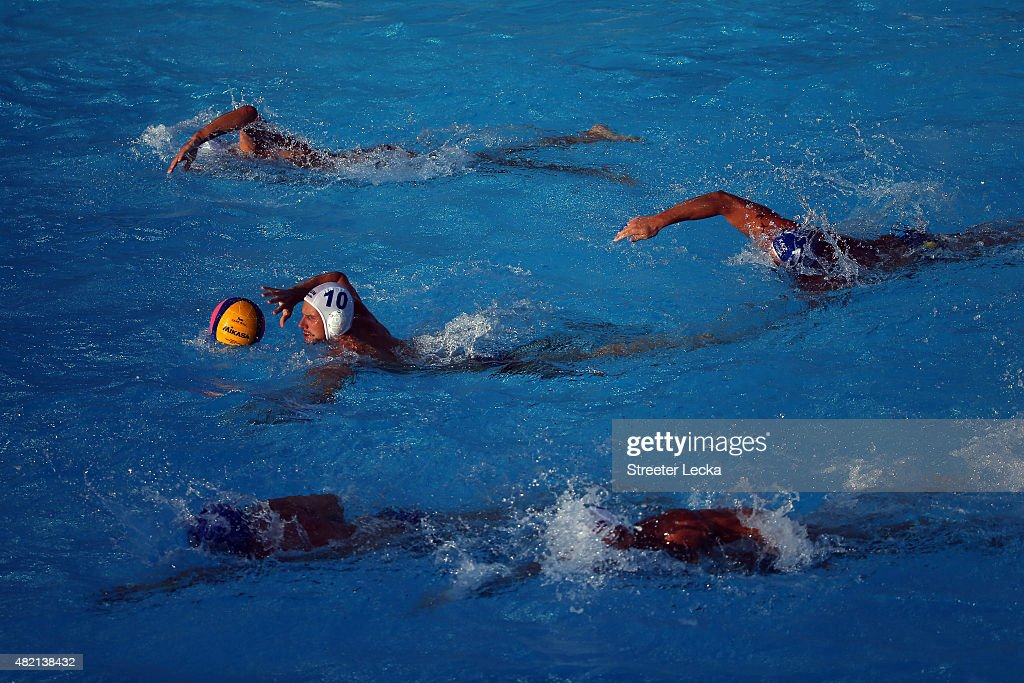 Denes Varga of Hungary drives on in the Men's Water Polo Preliminary Round group C match between Hungary and Kazakhstan on day three of the 16th FINA...