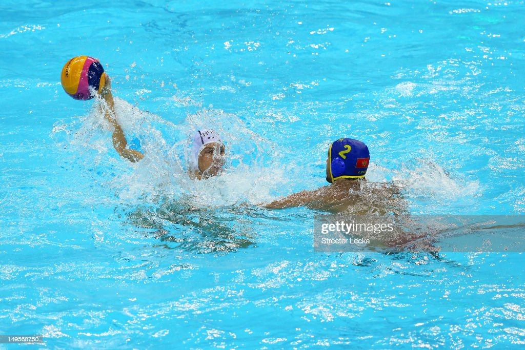 Denes Varga #4 of Hungary protects the ball against Drasko Brguljan #2 of Montenegro during their Men's Water Polo preliminary round Group B match on Day 4 of the London 2012 Olympic Games at Water Polo Arena on July 31, 2012 in London, England.