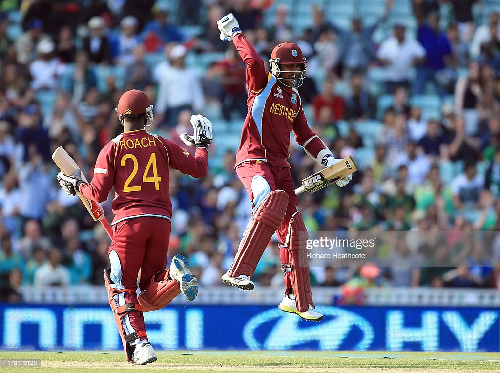 Denesh Ramdin (r) and Kemar Roach of West Indies celebrate victory during the ICC Champions Trophy group B match between West Indies and Pakistan at The Oval on June 7, 2013 in London, England.