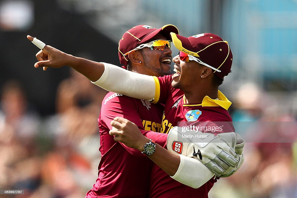 Denesh Ramdin (L) and Lendl Simmons (R) of West Indies celebrate after taking a catch during the 2015 ICC Cricket World Cup match between Pakistan and the West Indies at Hagley Oval on February 21, 2015 in Christchurch, New Zealand.