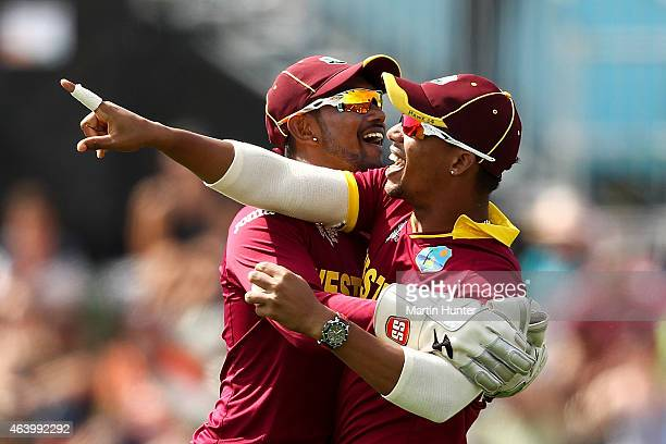 Denesh Ramdin and Lendl Simmons of West Indies celebrate after taking a catch during the 2015 ICC Cricket World Cup match between Pakistan and the...