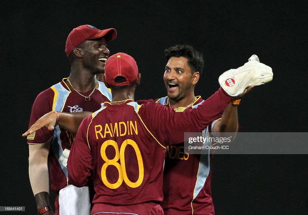 <a gi-track='captionPersonalityLinkClicked' href=/galleries/search?phrase=Denesh+Ramdin&family=editorial&specificpeople=542842 ng-click='$event.stopPropagation()'>Denesh Ramdin</a> and <a gi-track='captionPersonalityLinkClicked' href=/galleries/search?phrase=Ravi+Rampaul&family=editorial&specificpeople=2924536 ng-click='$event.stopPropagation()'>Ravi Rampaul</a> of West Indies celebrate after dismissing Cameron White of Australia during the ICC World T20 Semi Final between Australia and West Indies at R. Premadasa Stadium on October 5, 2012 in Colombo, Sri Lanka.