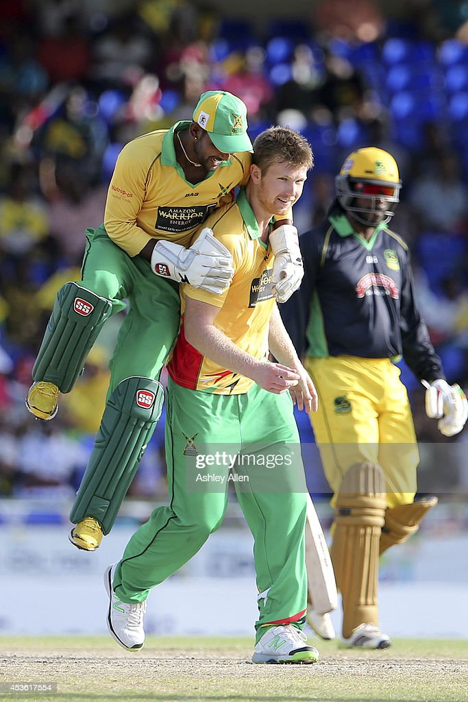 <a gi-track='captionPersonalityLinkClicked' href=/galleries/search?phrase=Denesh+Ramdin&family=editorial&specificpeople=542842 ng-click='$event.stopPropagation()'>Denesh Ramdin</a> (L) celebrates with team mate <a gi-track='captionPersonalityLinkClicked' href=/galleries/search?phrase=Jimmy+Neesham&family=editorial&specificpeople=6680337 ng-click='$event.stopPropagation()'>Jimmy Neesham</a> (C) as he gets the wicket of Chris Gayle (R) during a Semifinal match between Jamaica Tallawahs and Guyana Amazon Warriors as part of the Limacol Caribbean Premier League 2014 at Warner Park on August 14, 2014 in Basseterre, St. Kitts and Nevis.