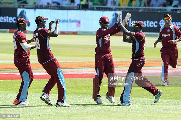 Denesh Ramdin of the West Indies celebrate the wicket of Hashim Amla of South Africa with his team mates during the 1st Momentum ODI between South...