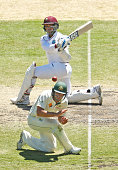 Denesh Ramdin of the West Indies hits a boundary past Joe Burns of Australia during day four of the Second Test match between Australia and the West...