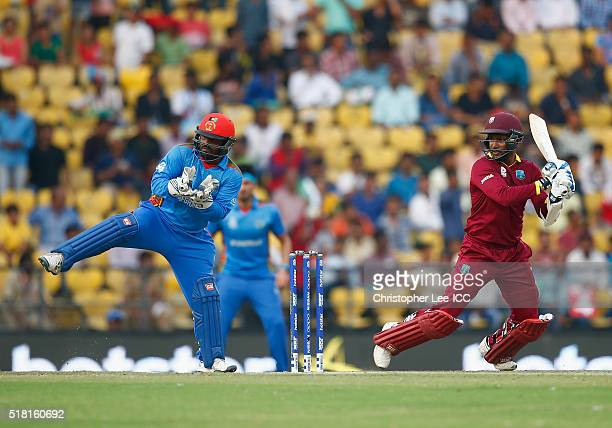 Denesh Ramdin of the West Indies in action with Mohammad Shahzad of Afghanistan during the ICC World Twenty20 India 2016 Group 1 match between...