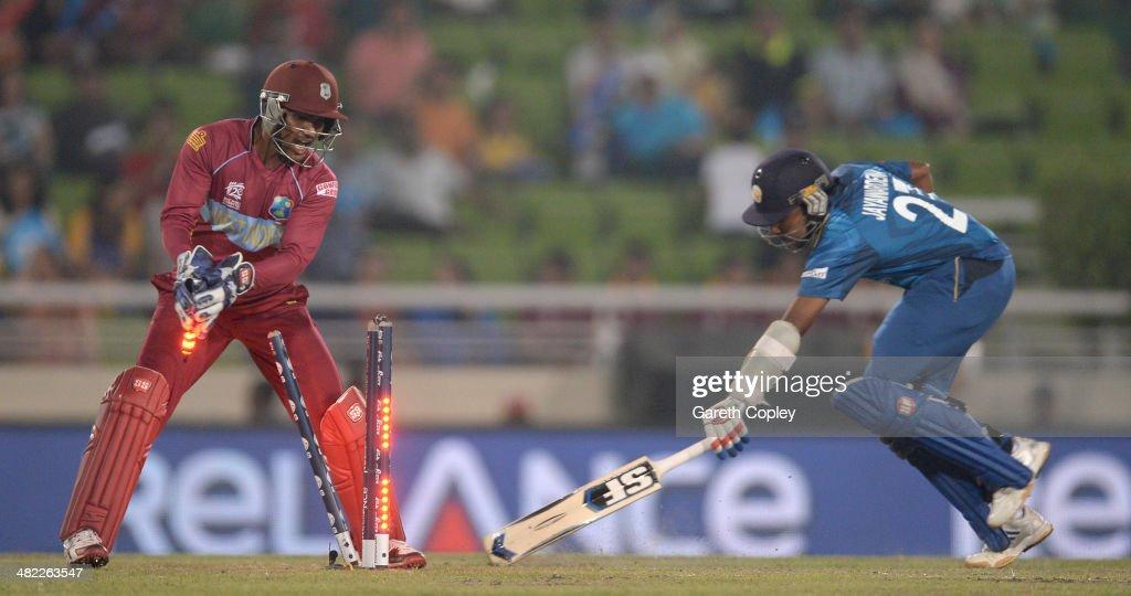Denesh Ramdin of the West Indies runs out Mahela Jayawardena of Sri Lanka during the ICC World Twenty20 Bangladesh 2014 semi final between Sri Lanka...