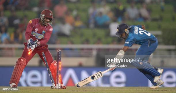 Denesh Ramdin of the West Indies runs out Mahela Jayawardena of Sri Lanka during the ICC World Twenty20 Bangladesh 2014 semi final between Sri Lanka...