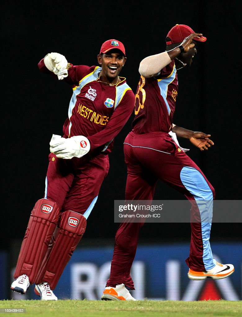 <a gi-track='captionPersonalityLinkClicked' href=/galleries/search?phrase=Denesh+Ramdin&family=editorial&specificpeople=542842 ng-click='$event.stopPropagation()'>Denesh Ramdin</a> of West Indies celebrates after taking a catch to dismiss Cameron White of Australia during the ICC World T20 Semi Final between Australia and West Indies at R. Premadasa Stadium on October 5, 2012 in Colombo, Sri Lanka.