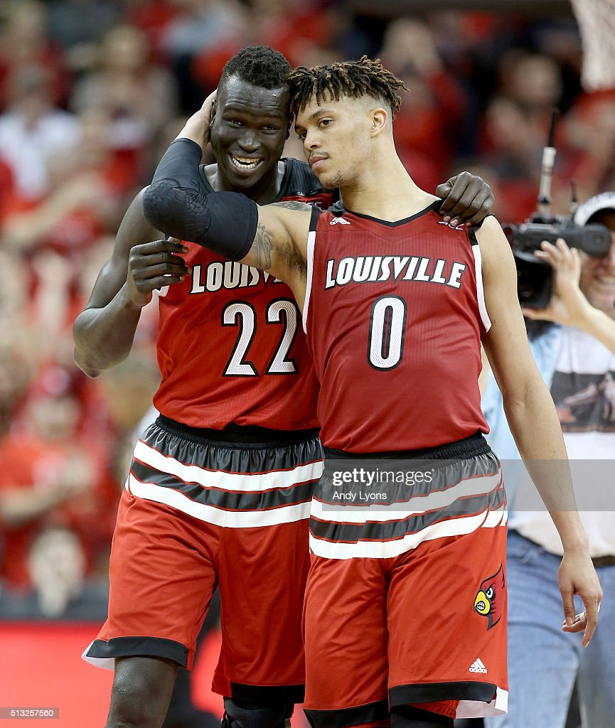 Deng Adel and Damion Lee of the Louisville Cardinals share a hug after the 5653 win over the Georgia Tech Yellow Jackets at KFC YUM Center on March 1...