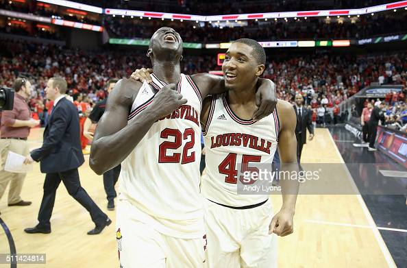 Deng Adel and Donovan Mitchell of the Louisville Cardinals celebrate after the 6660 win over the Duke Blue Devils at KFC YUM Center on February 20...