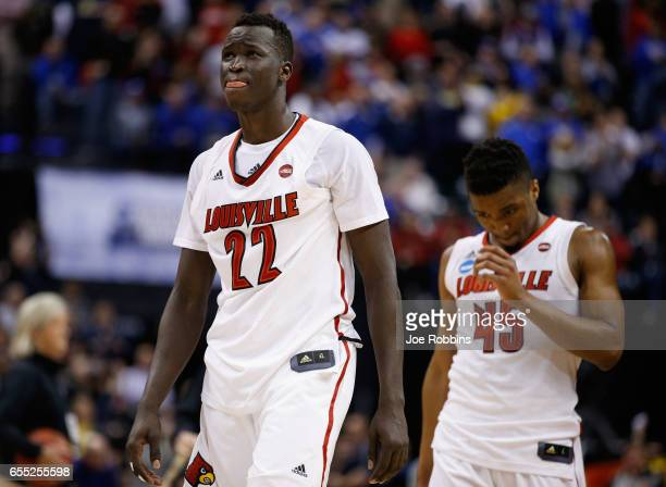Deng Adel and Donovan Mitchell of the Louisville Cardinals react to their 6973 loss to the Michigan Wolverines during the second round of the 2017...