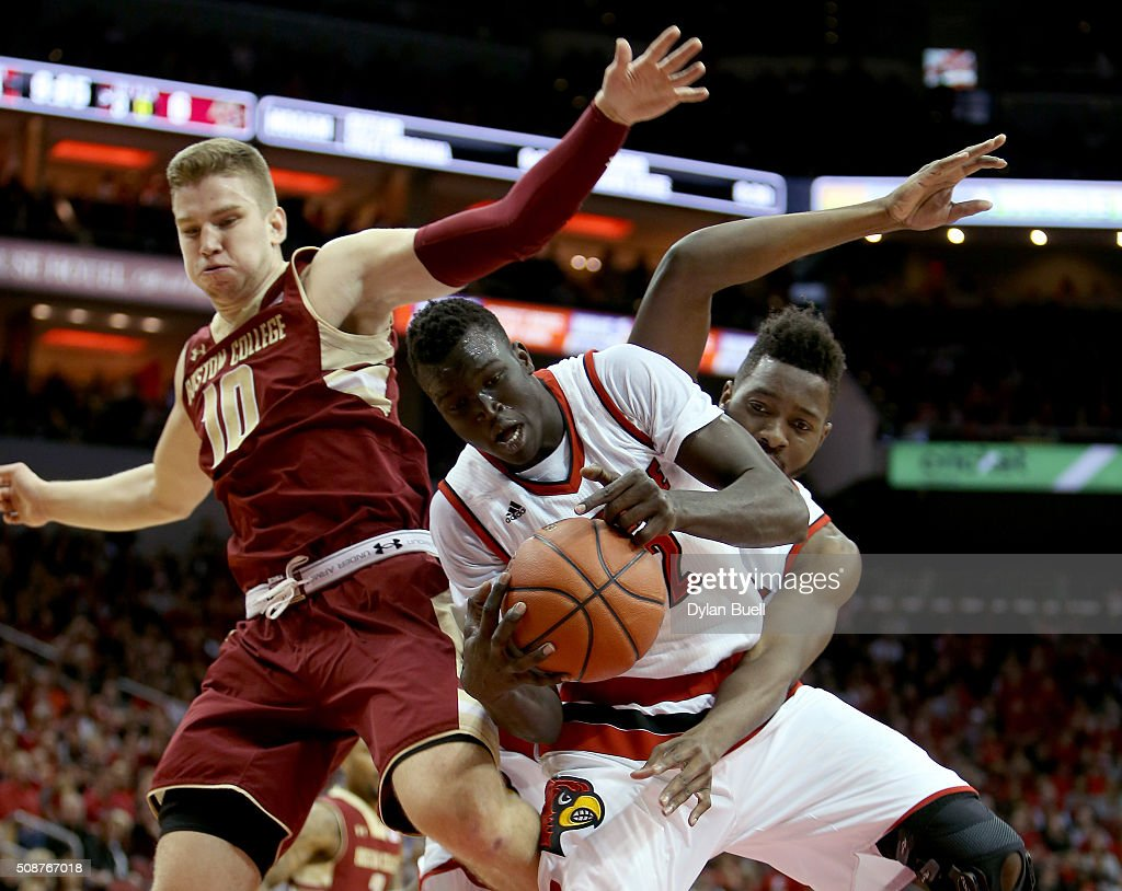 Deng Adel #22 of the Louisville Cardinals grabs a rebound in front of Chinanu Onuaku #32 of the Louisville Cardinals and Ervins Meznieks #10 of the Boston College Eagles during the first half at KFC Yum! Center on February 6, 2016 in Louisville, Kentucky.