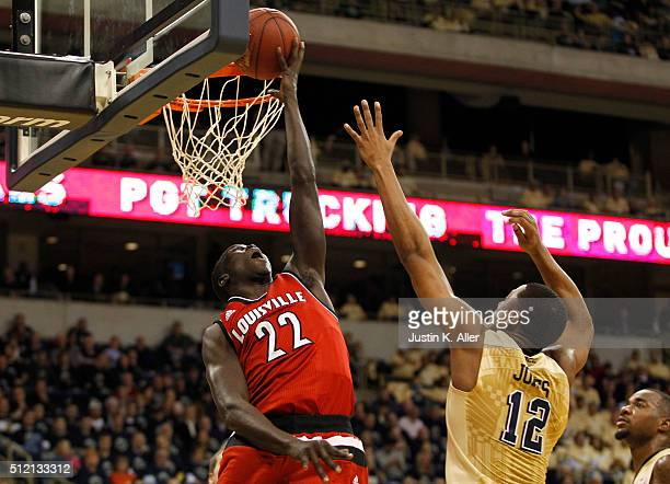 Deng Adel of the Louisville Cardinals lays one in during the game against Chris Jones of the Pittsburgh Panthers at Petersen Events Center on...