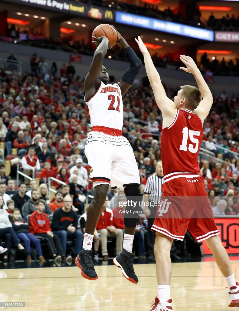 Deng Adel #22 of the Louisville Cardinals shoots the ball during the game against the Indiana Hoosiers at KFC YUM! Center on December 9, 2017 in Louisville, Kentucky.