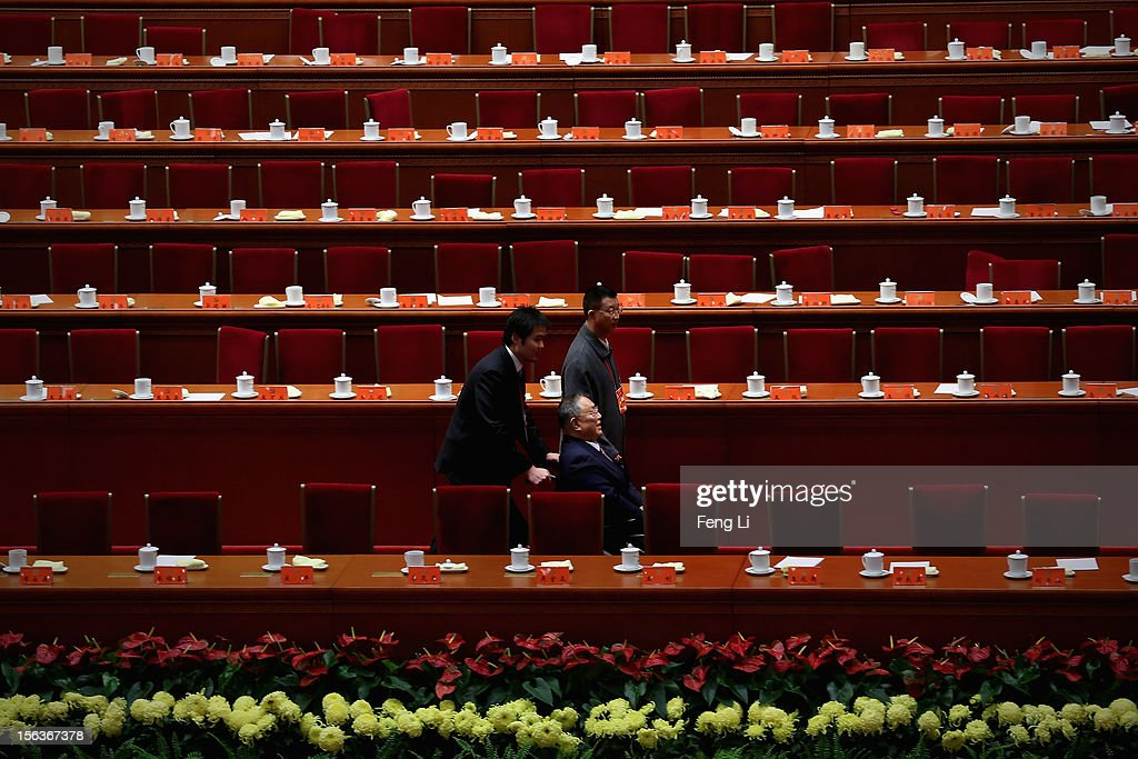 Deng Pufang, the first son of former China's Paramount leader Deng Xiaoping, leaves after the closing session of the 18th National Congress of the Communist Party of China (CPC) inside the Great Hall of the People on November 14, 2012 in Beijing, China. Members of the Standing Committee of the Political Bureau of the new CPC Central Committee will meet with journalists on November 15, 2012.