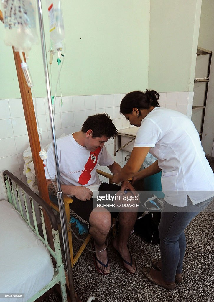A dengue fever patient receives treatment in a hospital in Asuncion, on January 16, 2013. According to Paraguay's Ministry of Health there are about 500 possible cases of dengue per day in the area of Asuncion. AFP PHOTO/Norberto Duarte