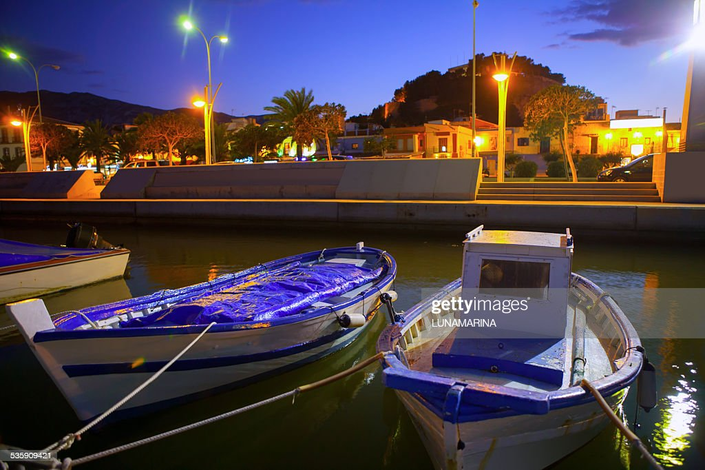 Denia port marina with traditional llaut boats at sunset night : Stock Photo
