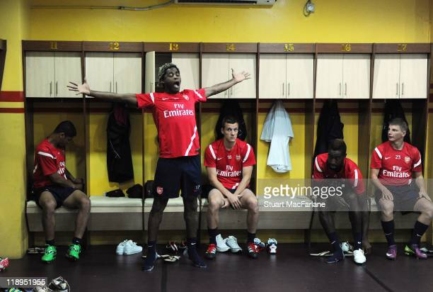 Denilson Alex Song Sebastien Squillaci Johan Djourou and Andrey Arshavin of Arsenal prepare in the dressing room before a training session at the...