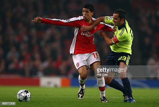 Denilson of Arsenal battles for the ball with Semih Senturk of Fenerbahce during the UEFA Champions League Group G match between Arsenal and...