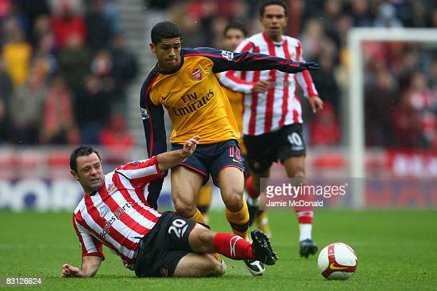 Denilson of Arsenal battles with Andy Reid of Sunderland during the Barclays Premier League match between Sunderland and Arsenal at the Stadium of...