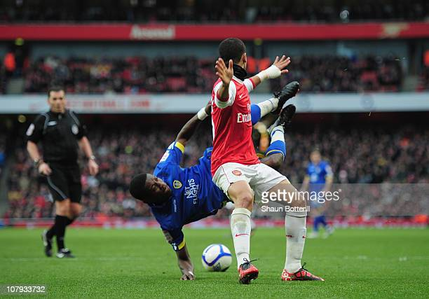 Denilson of Arsenal challenges Max Gradel of Leeds United to concede a penalty during the FA Cup sponsored by EON 3rd Round match between Arsenal and...