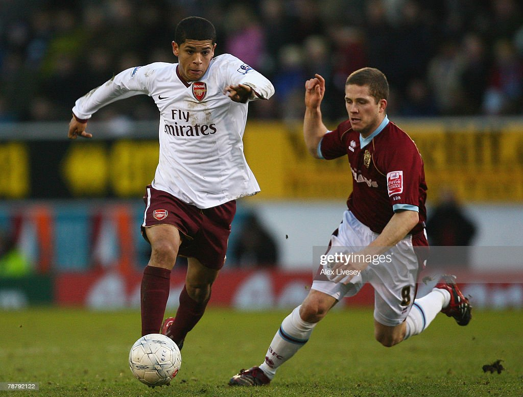 Denilson of Arsenal takes the ball past Joey Gudjonsson of Burnley during the FA Cup sponsored by E.ON Third Round match between Burnley and Arsenal at Turf Moor on January 6, 2008 in Burnley, England.