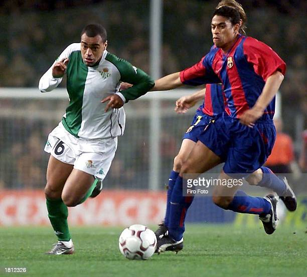 Denilson of Betis and Michael Reiziger of Barcelona in action during the match between Barcelona and Real Betis at the Nou Camp Barcelona Spain on...
