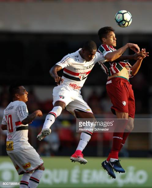 Denilson of Sao Paulo and Lucas of Fluminense in action during the match between Sao Paulo and Fluminense for the Brasileirao Series A 2017 at...