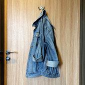 Denim jacket hanging on a hook at the door