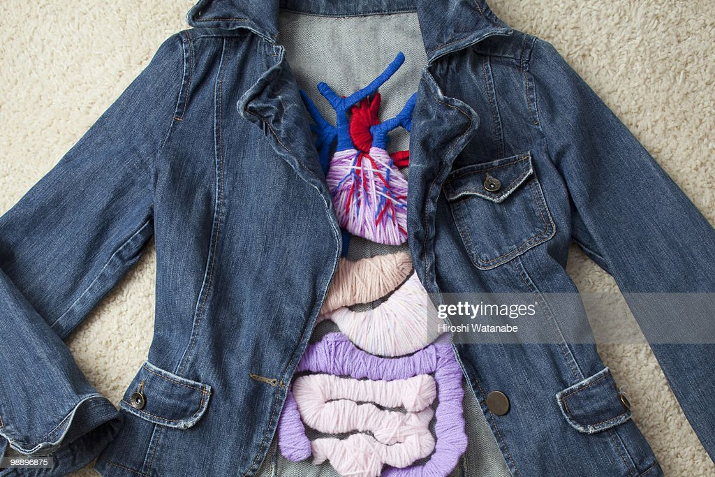 A denim jacket with the applique of the internal o : Stock Photo