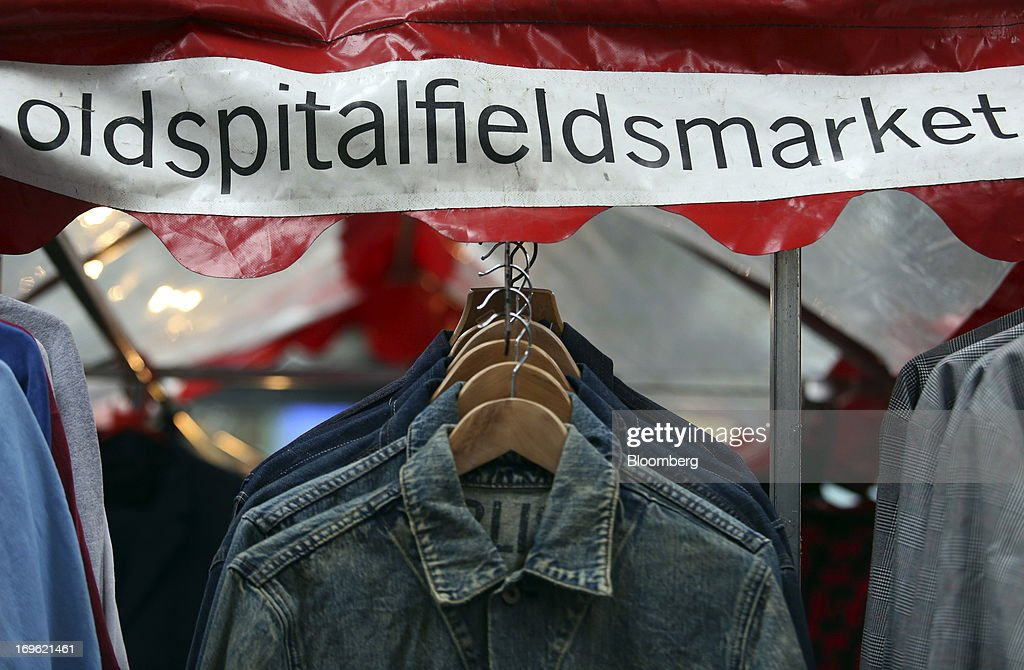 Denim jackets hang on display at a clothing stall at Old Spitalfields Market in London, U.K., on Wednesday, May 29, 2013. Annual U.K. consumer-price inflation slowed to 2.4 percent last month from 2.8 percent in March, the Office for National Statistics said May 21. Photographer: Chris Ratcliffe/Bloomberg via Getty Images