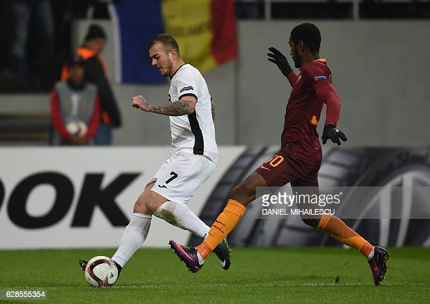 Denis Alibec of Astra Giurgiu vies for the ball with Gerson of AS Roma during the UEFA Europa League Group E football match between FC Astra Giurgiu...