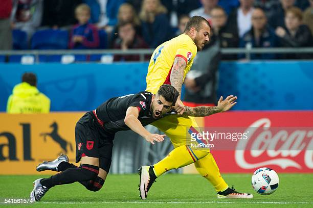 Denis alibec of Romania and Elseid Hysaj of Albania during the UEFA Euro 2016 Group A match between Romania and Albania at Stade de Lyon in Lyon...