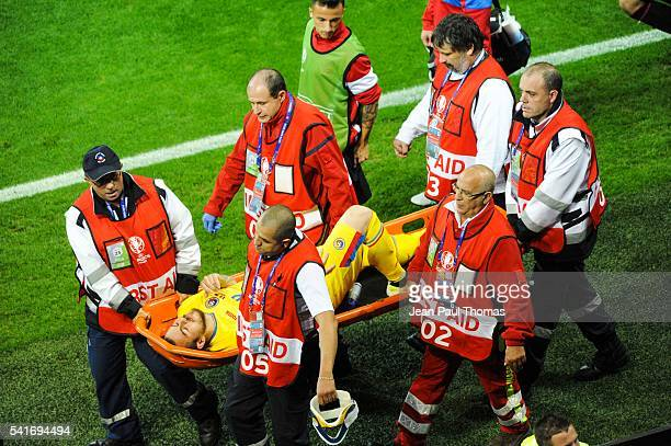 Denis ALIBEC of Romania is injured during the UEFA EURO 2016 Group A match between Romania and Albania at Stade des Lumieres on June 19 2016 in Lyon...