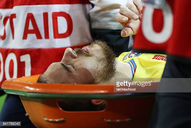 Denis Alibec of Romania is stretchered off the pitch during the UEFA EURO 2016 Group A match between Romania and Albania at Stade des Lumieres on...