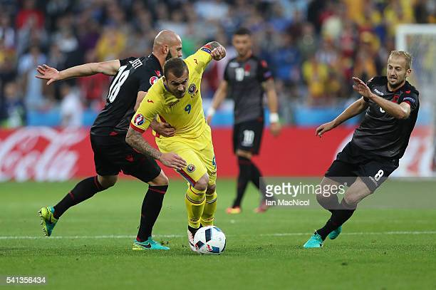 Denis Alibec of Romania vies with Arlind Ajeti of Albania during the UEFA EURO 2016 Group A match between Romania and Albania at Stade des Lumieres...