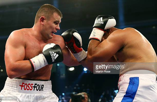 Denis Boytsov of Russia exchanges punches with Alex Leapai of Australia during their WBO Asia Pacific Heavyweight Championship fight at brose Arena...