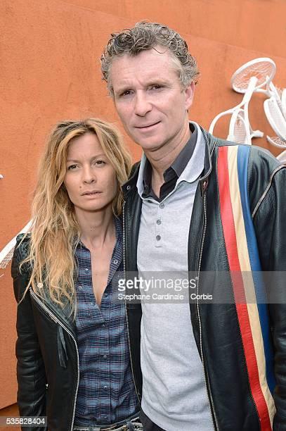 Denis Brogniart and his wife Hortense at Roland Garros Village