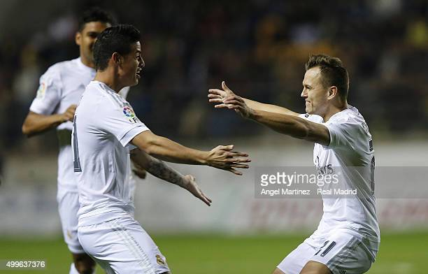 Denis Cheryshev of Real Madrid celebrates with James Rodriguez after scoring the opening goal during the Copa del Rey round of 32 first leg match...