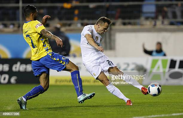 Denis Cheryshev of Real Madrid scores the opening goal past Cristian Marquez of Cadiz during the Copa del Rey round of 32 first leg match between...