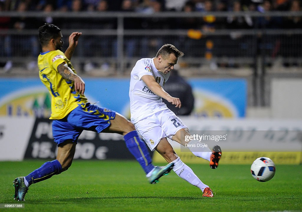 Denis Cheryshev of Real Madrid shoots past Cristian Marquez of Cadiz to score his team's opening goal during the Copa del Rey Round of 32 First Leg...