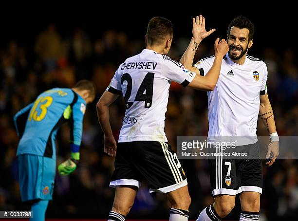 Denis Cheryshev of Valencia celebrates scoring his team's second goal with his teammate Alvaro Negredo during the La Liga match between Valencia CF...