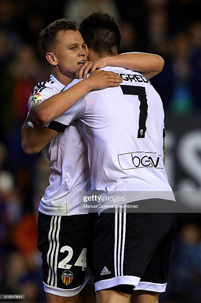 Denis Cheryshev of Valencia celebrates scoring his team's second goal with his teammate Alvaro Negredo during the La Liga match between Valencia CF and RCD Espanyol at Estadi de Mestalla on February 13, 2016 in Valencia, Spain.