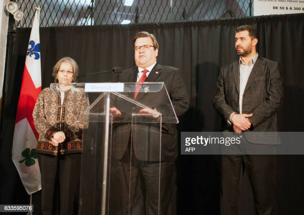 Denis Coderre the mayor of Montreal speaks next to Marouan Hamdi the coordinator of the Badr Islamic Center at the funeral of three of the six...