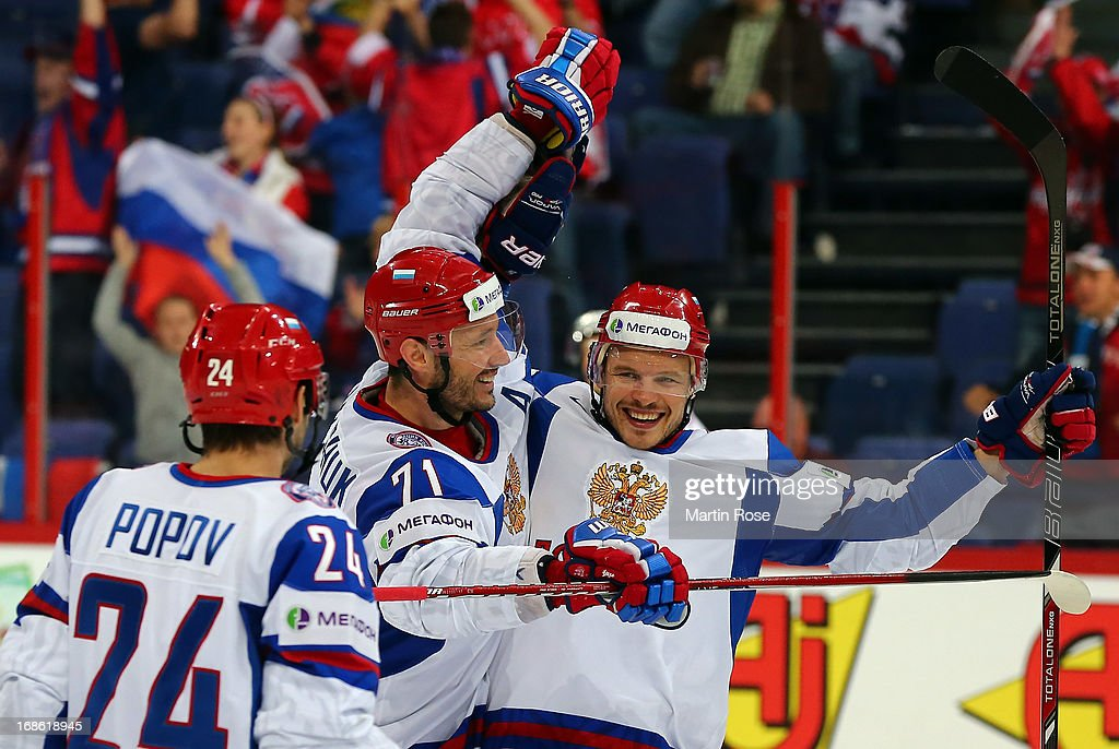 Denis Denisov (R) of Russia celebrate with his team mates after he scores his team's 3rd goal during the IIHF World Championship group H match between Slovakia and Russia at Hartwall Areena on May 12, 2013 in Helsinki, Finland.