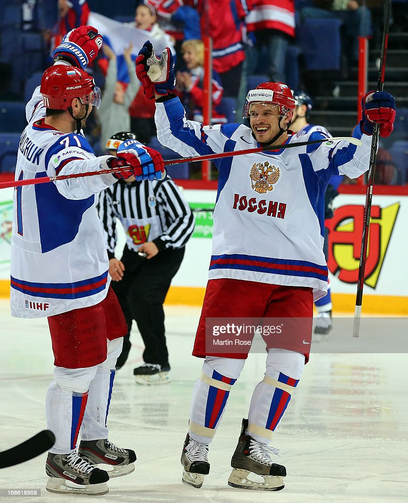 Denis Denisov (R) of Russia celebrate with team mate Ilya Kovalchuk after he scores his team's 3rd goal during the IIHF World Championship group H match between Slovakia and Russia at Hartwall Areena on May 12, 2013 in Helsinki, Finland.