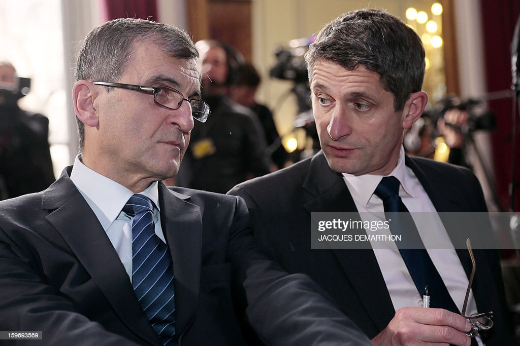 Denis Favier (R) and Jacques Meris, advisors of French Interior minister respectively for Gendarmerie matters and police matters attend the presentation by French Interior minister of the report of the past year and the prospects of the security policy for the upcoming yearon January 18, 2013 at the ministry in Paris.